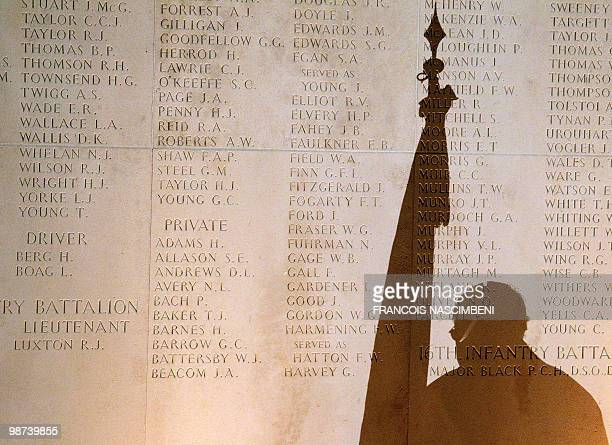 The shadow of an Australian veteran is cast on a memorial wall as he attends a dawn service commemorating Anzac Day on the WWI battlefield of...