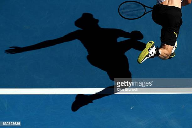 The shadow of Andy Murray of Great Britain is seen as he serves in his fourth round match against Mischa Zverev of Germany on day seven of the 2017...
