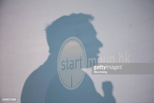 The shadow of billionaire Elon Musk chief executive officer of Tesla Motors Inc is cast on a wall as he speaks during the StartmeupHK Venture Forum...