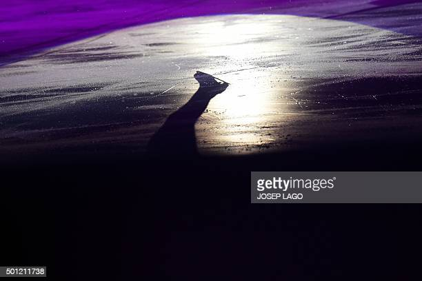 The shadow of Canadian skater Patrick Chan is projected on the ice as he performs during an exhibiton gala at the ISU Grand Prix of Figure Skating...