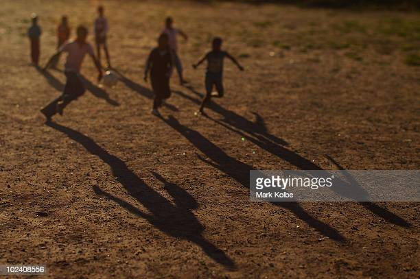 The shadow of children playing football are seen at the Lawaaikamp Sport ground at a Japan football team township visit during the FIFA 2010 World...