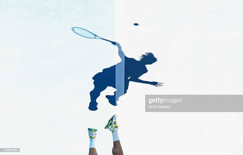 The shadow of David Ferrer of Spain is seen on the court as he serves in his Quarterfinal match against Nicolas Almagro of Spain during day nine of the 2013 Australian Open at Melbourne Park on January 22, 2013 in Melbourne, Australia.