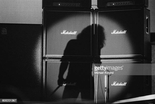 The shadow of English singer Paul Rodgers in front of a stack of Marshall amplifiers during a performance with rock group Bad Company at The Great...