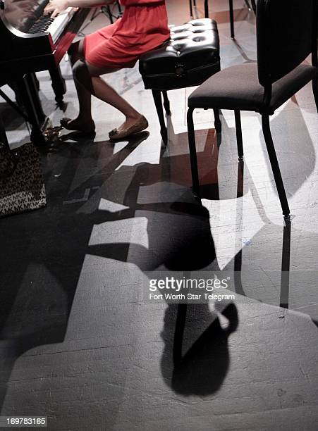 The shadow of FeiFei Dong of China is cast across the stage as she practices alone after her rehearsal with the chamber orchestra as the 14th Van...