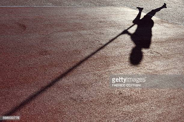TOPSHOT The shadow of France's Renaud Lavillenie is seen during a warm up during the Men's Pole Vault event during the Diamond League Athletics...