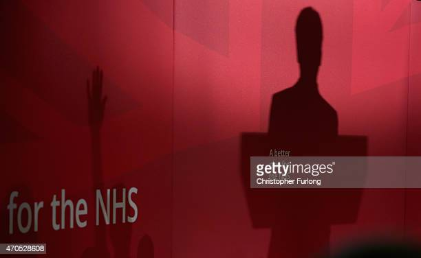 The shadow of labour Party leader Ed Miliband falls on the staging during a speech on the Party's NHS rescue plan at the Brooks Building Manchester...