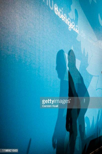 The shadow of newly elected Prime Minister of Thuringia Thomas Kemmerich of the Free Democratic Party FDP speaks during a press conference on...