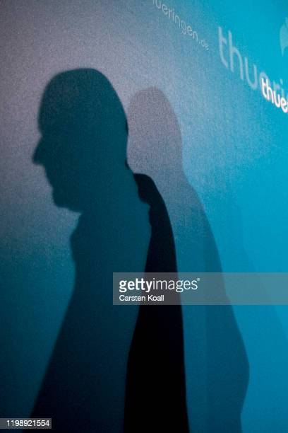 The shadow of newly elected Prime Minister of Thuringia Thomas Kemmerich, of the Free Democratic Party (FDP, speaks during a press conference on...