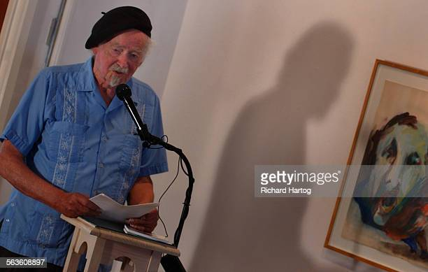 The shadow of poet George Hitchcock can be seen on the wall as he reads to a full house at the The Adobe Krow Sunday afternoon in downtown...