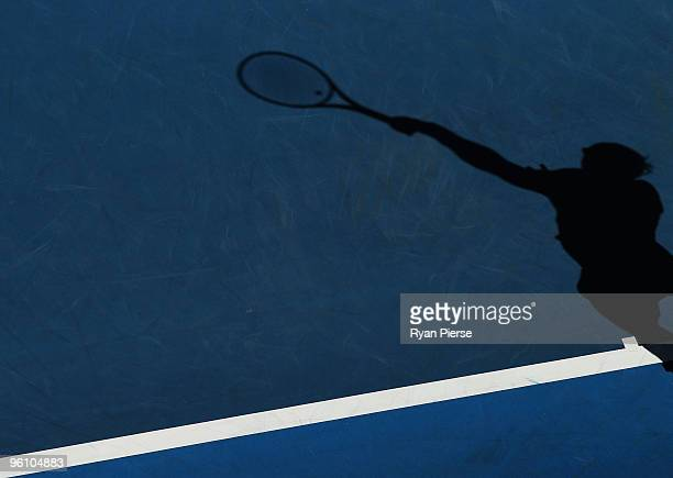 The shadow of Rafael Nadal of Spain serving in his fourth round match against Ivo Karlovic of Croatia during day seven of the 2010 Australian Open at...