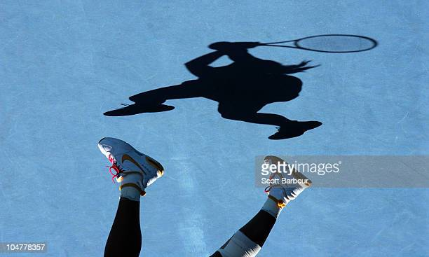 The shadow of Serena Williams of the United States of America is seen on the court as she plays a backhand in her quarterfinal match against Victoria...