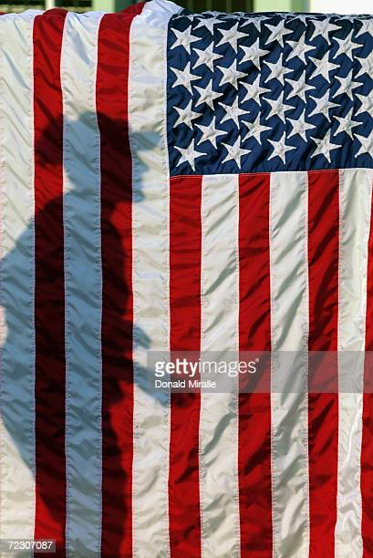 The shadow of Softball legend Lisa Fernandez of the USA is cast upon a American Flag during the USA versus Columbia Women's Softball Game at the...