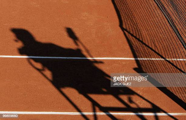 The shadow of the arm chair is seen during the French Open tennis tournament at Roland Garros in Paris 24 May 2004 AFP PHOTO JACK GUEZ
