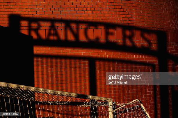 The shadow of the gates is cast on a wall at Ibrox Stadium on February 15 2012 in Glasgow Scotland The Clydesdale Bank Premier League club entered...