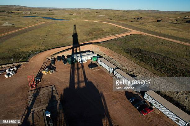 The shadow of the Raven Oil Drilling rig stretches across the North Dakota fields near Watford City ND Oct 1 2013 In 2008 the North Dakota oil boom...