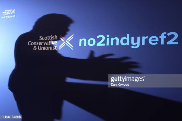The shadow of UK Prime Minister and Conservative Party leader Boris Johnson is reflected as he launches the Conservative Party Scottish Manifesto on...