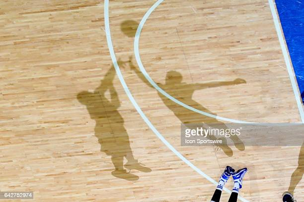 The shadow of Villanova Wildcats forward Kris Jenkins shoots over the shadow of Seton Hall Pirates forward Michael Nzei during the second half of the...