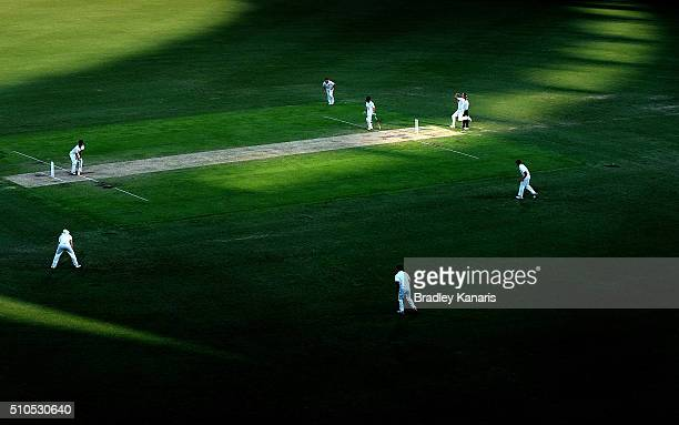 The shadows from the late afternoon light fall across the Gabba pitch as Jack Wildermuth of Queensland bowls to Jake Doran of Tasmania during day...