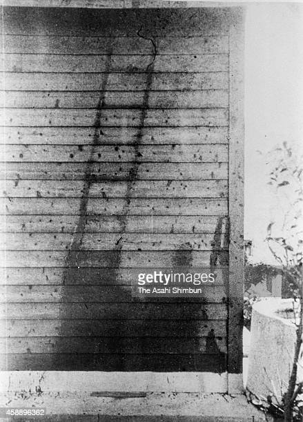 The shadows of a man and a ladder were projected on a wooden house by the energy of the atomic bomb 'Fat Man' dropped on September 1 1945 in Nagasaki...