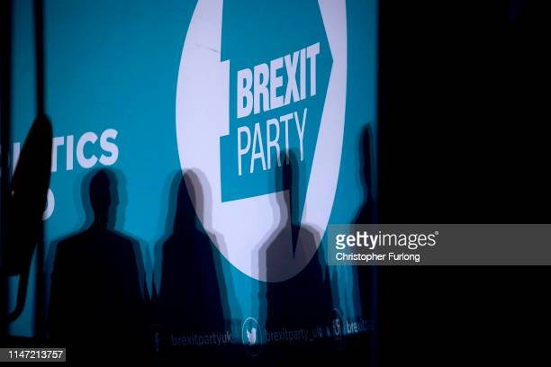 The shadows of Brexit Party members and Party Leader Nigel Farage are seen on stage during a rally at The Broadway Theatre on June 01 2019 in...