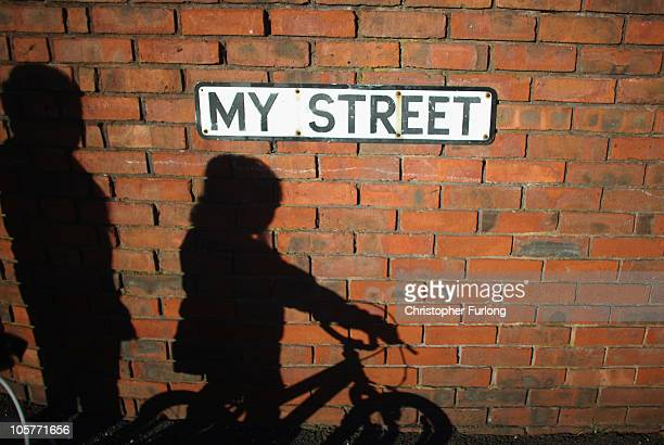 The shadows of children playing are cast on the wall of My Street in Salford which has a high percentage of council homes on October 20 2010 in...