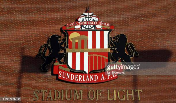 The shadows of flags show against the club crest of Sunderland during the Sky Bet League One match between Sunderland and Lincoln City at Stadium of...