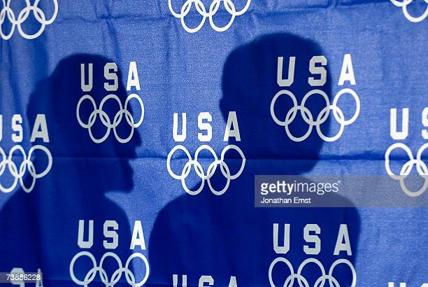 The shadows of Los Angeles bid committee members Barry Sanders and Mayor Antonio Villaraigosa are seen during a news conference they held after...