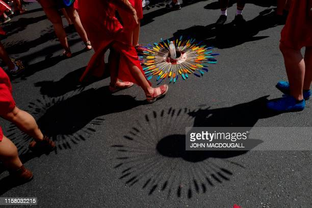 The shadows of the costumes are seen on the ground during the Christopher Street Day gay pride parade in Berlin on July 27 2019 Gays and lesbians all...