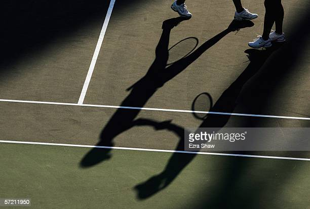 The shadows of Tiantian Sun of China and her partner and countrywoman Ting Li as they shake hands during the women's doubles quarterfinals match...