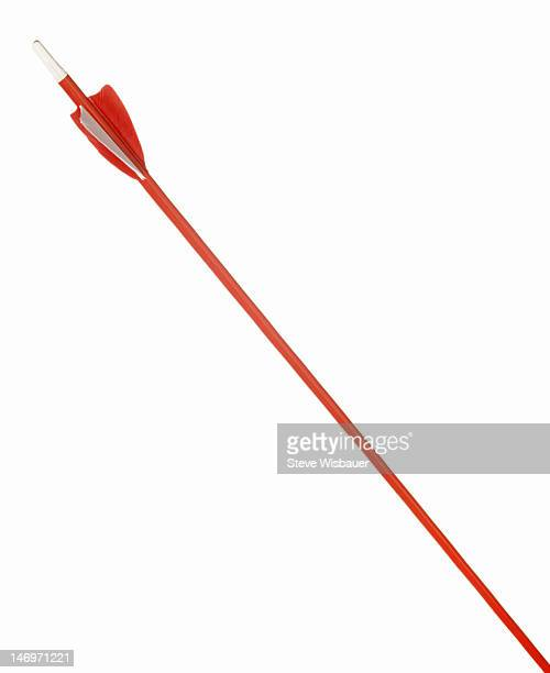 The shaft and fletching of a red arrow