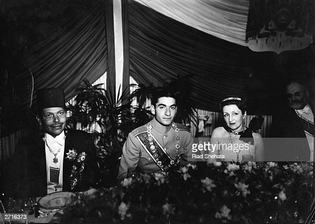 The Shah of Iran Mohamed Mahoud Pash and the Prince of Iran at table