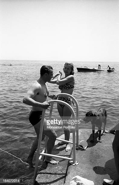 The Shah of Iran Mohammad Reza Pahlavi climbs the ladder after a swim Capri the Fifties