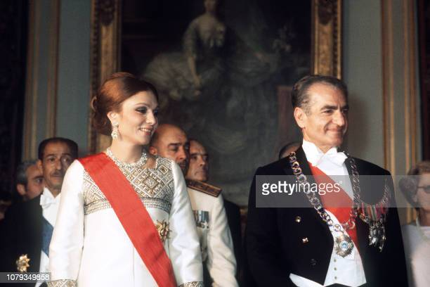 The Shah of Iran Mohammed Reza Pahlavi and his wife Farah Diba visit on June 24 1974 the Chateau de Versailles