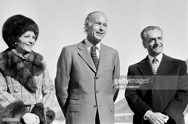 The Shah of Iran Mohammed Reza Shah Pahlavi and HIM Farah Pahlavi Empress of Iran greet French President Valery Giscard d'Estaing and his wife after...