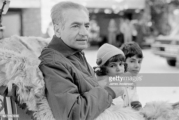 The Shah of Iran Mohammed Reza Shah Pahlavi and his two youngest children Leila Pahlavi and AliReza Pahlavi take a sleigh ride while on winter...