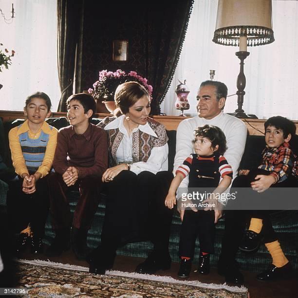 The Shah of Iran with his third wife Farah Diba and their children Prince Reza Prince Ali Reza and the two younger children Princess Farahnaz and...