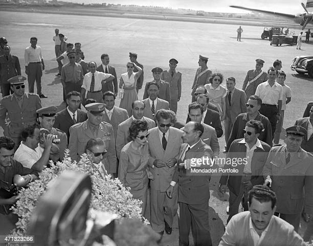 The Shah of Persia Mohammad Reza Pahlavi and his wife Soraya Esfandiary Bakhtiari being welcomed at the airport by some functionaries Ciampino 1953