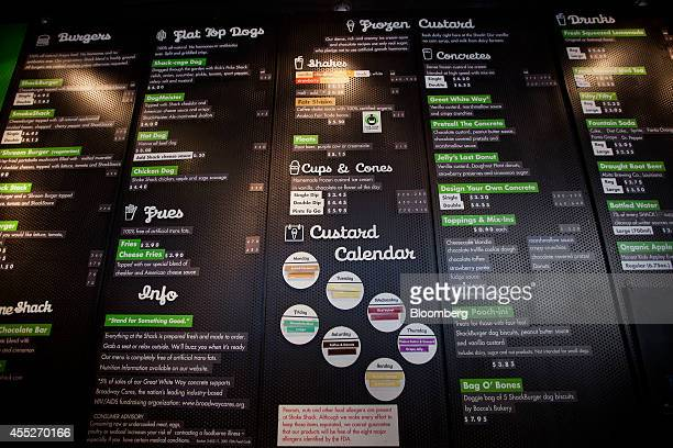 The Shake Shack menu is displayed inside a restaurant location in New York US on Wednesday Sept 10 2014 Shake Shack the burger chain started by...