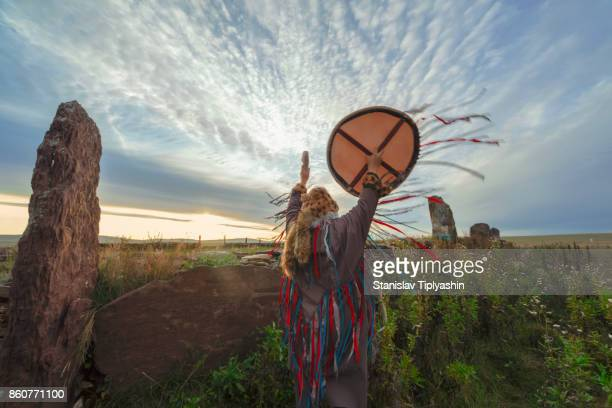 The shaman performs the rite at sunrise.