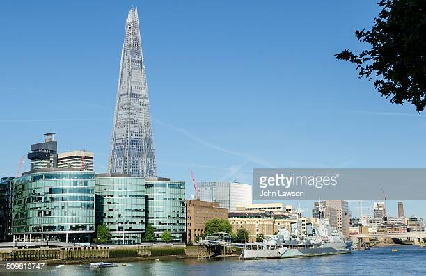The Shard Europe's tallest skyscraper and the South Bank of the River Thames London England UK taken early on a sunny summer morning In front of The...