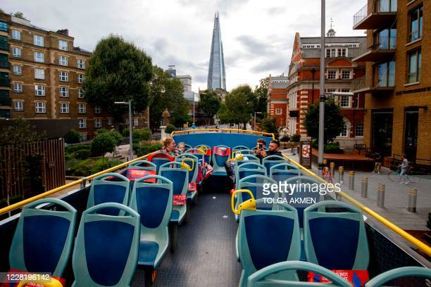 The Shard is seen from a near-empty open-top tourist tour bus in central London on August 24, 2020. - For those tourists who do run the gauntlet of...