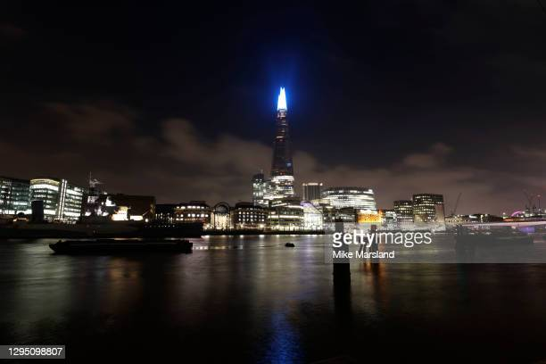 The Shard London is lit up blue in Support Of The NHS on January 07, 2021 in London, England. In a renewed gesture of thanks to the NHS workers and...