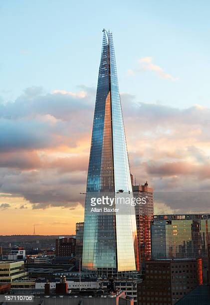 the shard skyscraper at sunset - shard london bridge stock pictures, royalty-free photos & images
