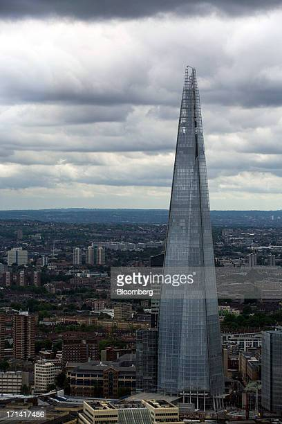 The Shard tower is seen on the south bank of the River Thames from the Swiss Re building also known as the 'Gherkin' in London UK on Sunday June 23...