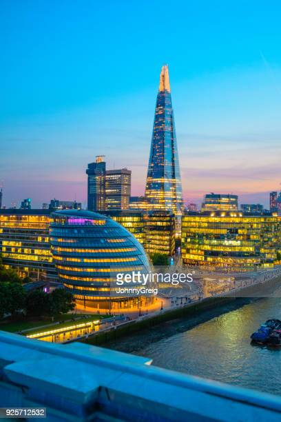 The Shard with office buildings at sunset