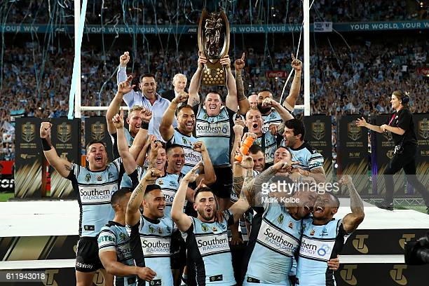 The Sharks celebrate with the Premiership Trophy after winning the 2016 NRL Grand Final match between the Cronulla Sharks and the Melbourne Storm at...
