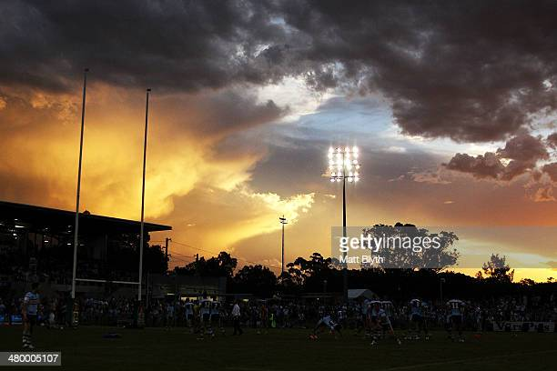 The Sharks warm-up before the round three NRL match between the Cronulla-Sutherland Sharks and the St George Illawarra Dragons at Remondis Stadium on...