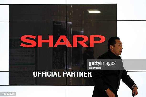 The Sharp Corp logo sits on a LCD display in Tokyo Japan on Friday Feb 1 2013 Sharp Corp the Japanese TVmaker that has warned about its ability to...