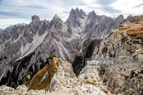 the sharp dolomite mountains in the italian alps. - 崖 ストックフォトと画像