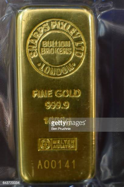 The Sharps Pixley Bullion Brokers logo is stamped on 1000g block of gold at Sharps Pixley Bullion Brokers on December 15 2015 in London England The...